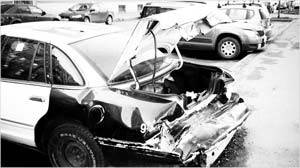 This image is a crashed car. Accidents, falls, dog bites happen extraordinarily fast. Someone is always responsible for the medical costs. The bills can be extremely high.